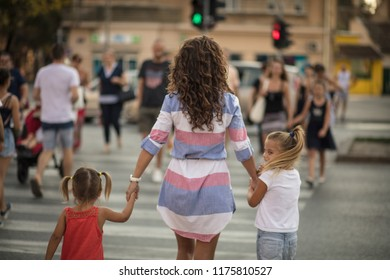 Safer. Mother walking with her daughter walking over the pedestrian crossing. Close up. Copy space.