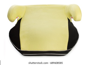 Safety booster seat for children, yellow car seat isolated on white background.