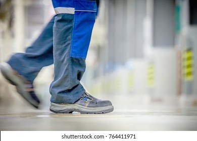Safety boots and trousers of a factory/industry worker.