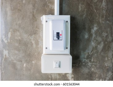 safety breaker and electric switch circuit  on the concrete wall