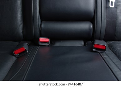 Safety buckle on the black seat in a car