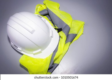 Safety concept : Helmet placed on a white wooden table. Industrial Applications for Workplace Safety Copy space
