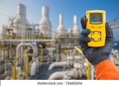 Safety concept of safety and security system on offshore oil and gas processing platform, hand hold gas detector for check hydrocarbon leak to protect fire and explosion.