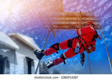 safety construction sprinkle from high by wear equipment protective on scaffolding with blue sky background