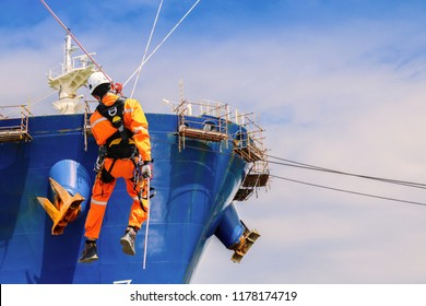 Safety demonstration of Sprinkle from high, wear equipment protective PPE, on Forward Cargo ship repair by Scaffolding in stalled at forecastle deck for hull steel work in shipyard Thailand background