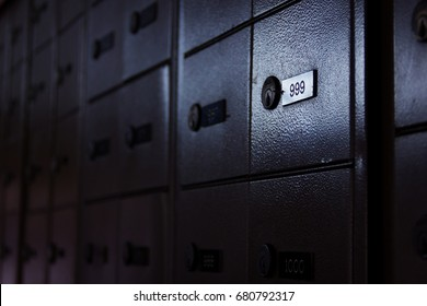 Safety deposit box with nine hundred ninety nine number highlighted in post office. Locker, security concept