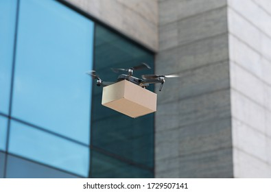 Safety drone delivery in the city, quadrocopter or drone delivering package, copy space