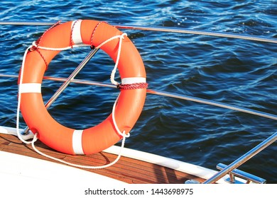 Safety equipment on a boat, life buoy or rescue buoy floating on sea. Concept to rescue people from drowning man.