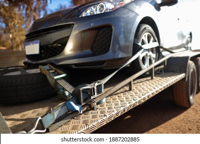 Safety first car using ratchet tension tightening ensure is't does move forward or backward while transporting relocating on trailer