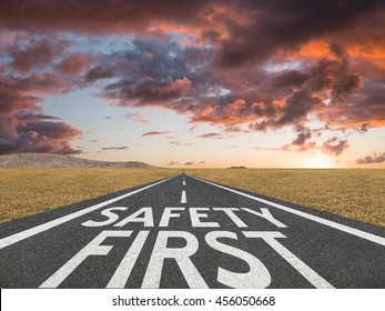 Safety First concept with motivational quote on highway