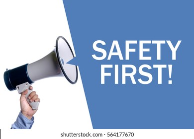 Safety First!. Hand with megaphone / loudspeaker. Business concept.