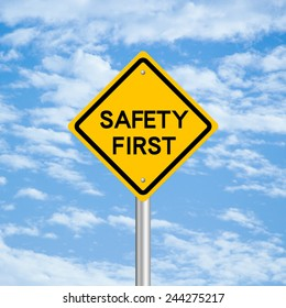 Safety first road sign with blue sky background.