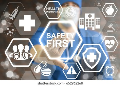 Safety First Work Concept - regulations and standard in health care. Top secure rules. Medicine protection, personal security people on job. Doctor pressing safety first button on virtual screen.