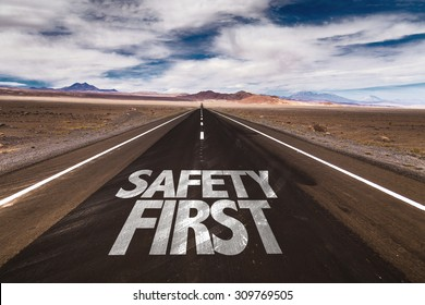 Safety First written on desert road