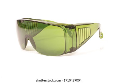 Safety green glasses for protection from laser radiation isolated on the white background