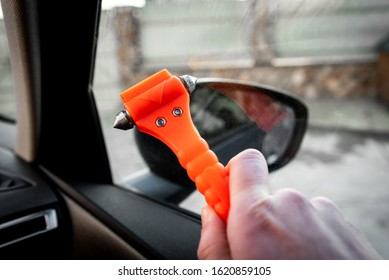 Safety hammer mounting and seatbelt cutter in car use in case accident.  - Shutterstock ID 1620859105
