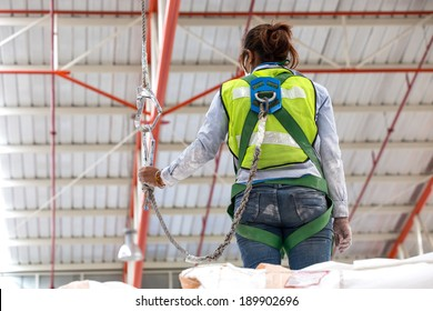 A safety harness is a form of protective equipment designed to protect a person, animal, or object from injury or damage. The harness is an attachment between a stationary and non-stationary object