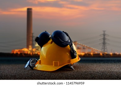 Safety hat on view of background power plant  for your work .Concept for safety and construction .
