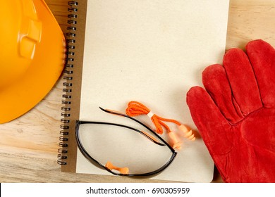 Safety hat,glove,glasses,ear plugs and note book. Health and safety concept.