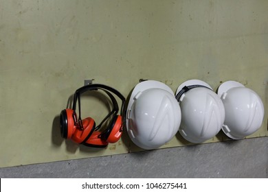 Safety hazard equipment, earplug and helmet in very loud construction site.Risk management concept.