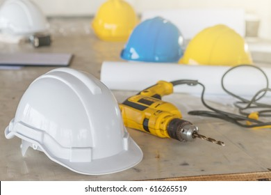 The safety helmet and the blueprint on table at construction site