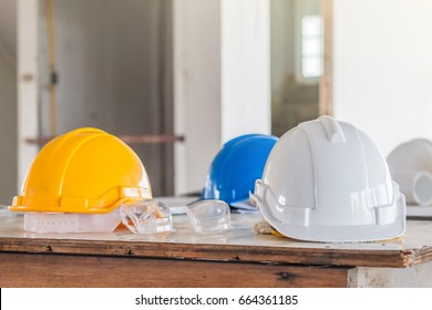 Architect desk businessengineering conceptconstruction site soft the safety helmet and the blueprint on table at construction site malvernweather Images