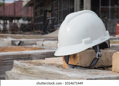 Safety helmet with construction site background blur.