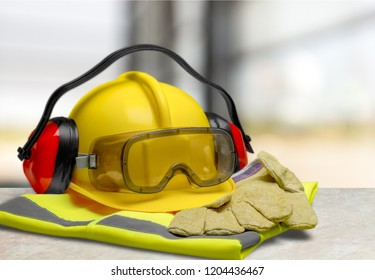 Safety helmet with earphones and goggles on