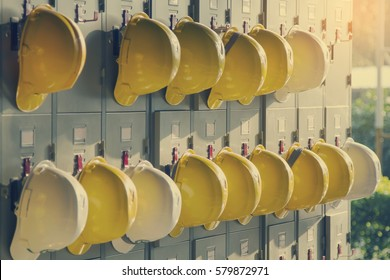 Safety helmet hanging on locker for worker equipment