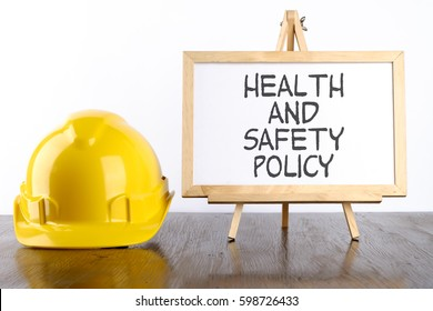 Safety helmet and white board with words Health and Safety Policy,Health and Safety concept.