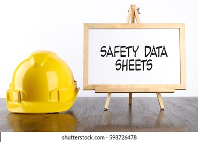 Safety helmet and white board with words Safety Data Sheets,Health and Safety concept.