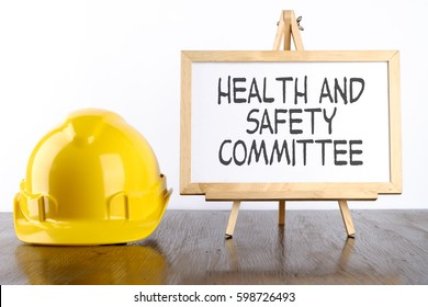 Safety helmet and white board with words Health and Safety Commitee,Health and Safety concept.
