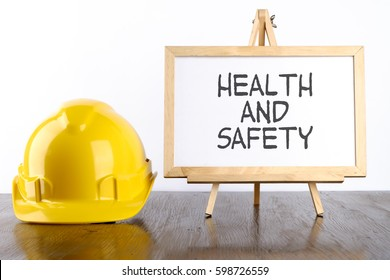 Safety helmet and white board with words Health and Safety,Health and Safety concept.