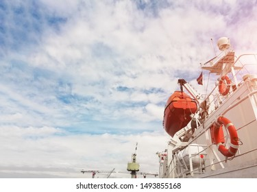 safety Lifeboat or rescue boat on deck of bulk ship near Life buoys, mast communication and navigation bridge deck during ship repair in shipyard