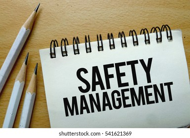 Safety Management text written on a notebook with pencils