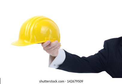 safety office or site manager holding out a hard hat advising of safety