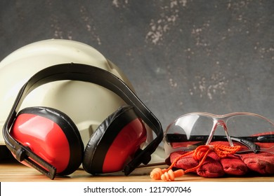 Safety Personal Protective Equipment(PPE) on a rustic black background.