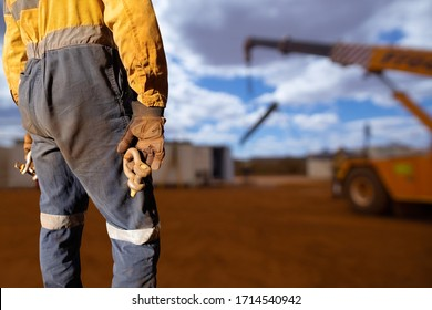 Safety practises clear image of rigger wearing safety hand glove protection holding bow shackle crane 3.2 ton lifting & rigging equipment with defocused crane lifting steel beam at the background