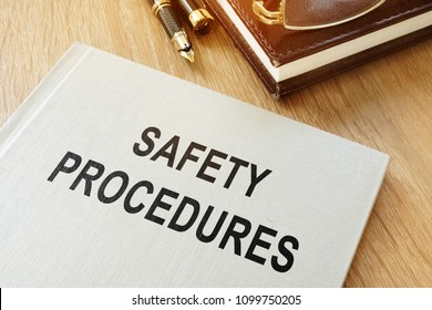 Safety procedures manual on an office desk.