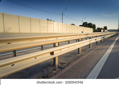 Safety rail on freeway with accoustic barrier
