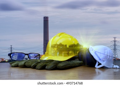 Safety in Refinery Concept , Double exposure of safety standard set  on working table, Background power plant , heavy petrochemical industry estate use for energy , power , fuel ,gas .