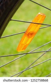 Safety reflector on bicycle wheel spokes.