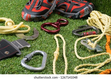safety ropes for mountains and red shoes on green grass, background