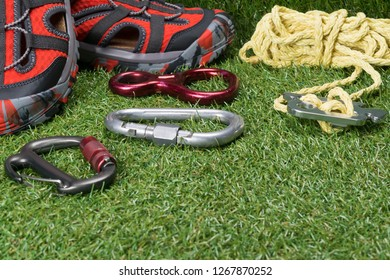 safety ropes for mountains and red shoes on the green grass, a place for your inscription