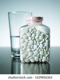 Safety sealed bottles of aspirin pills commonly used as an anti-inflamatory and pain relief medication also to lessen the risk and severity of heart attack