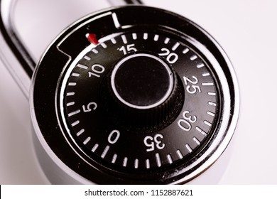 Safety or security concept, close up of code numbers on combination pad lock, locking device in which a sequence of symbols or numbers, is used to open the lock.