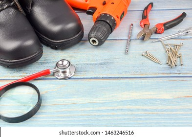 Safety shoes with tools on wooden background. Osha concept Occupational Safety Health and Administration. Copy space for your text.