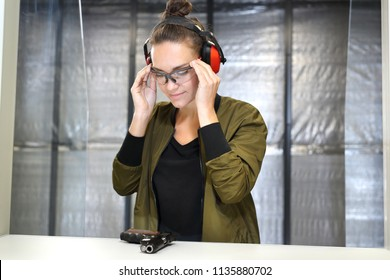 Safety at the shooting range. A woman at the shooting range.