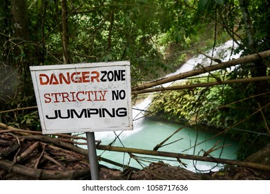 Safety sign. Danger Zone warning. No Jumping sign. Danger zone at waterfall.