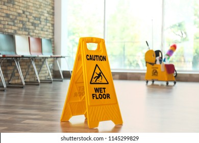 Safety sign with phrase Caution wet floor, indoors